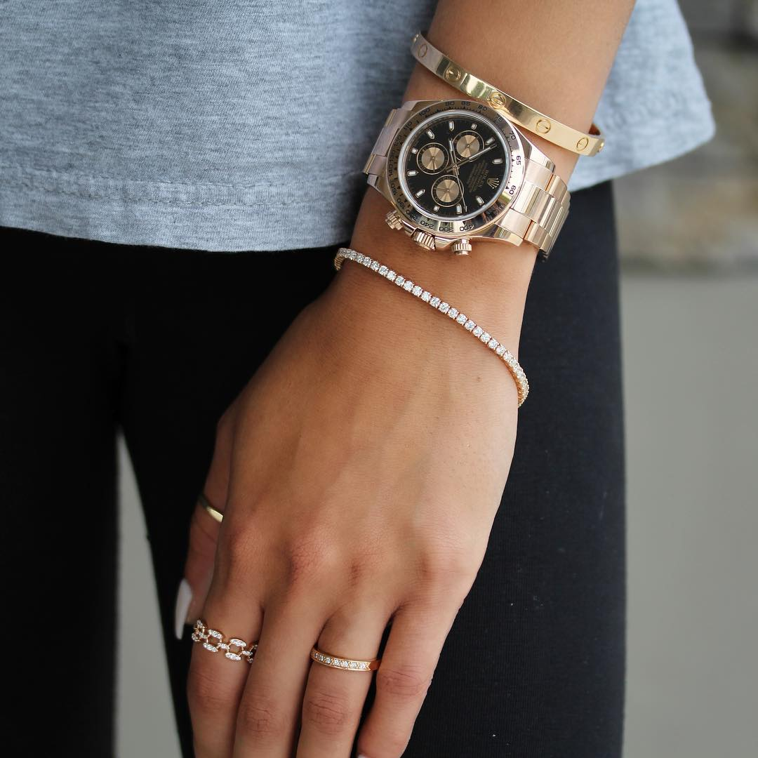 woman wearing mens watches trend