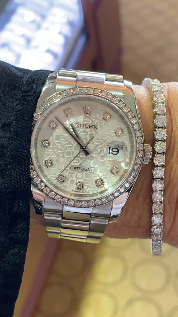 diamond tennis bracelet and rolex mother of pearl dial and diamond pairing