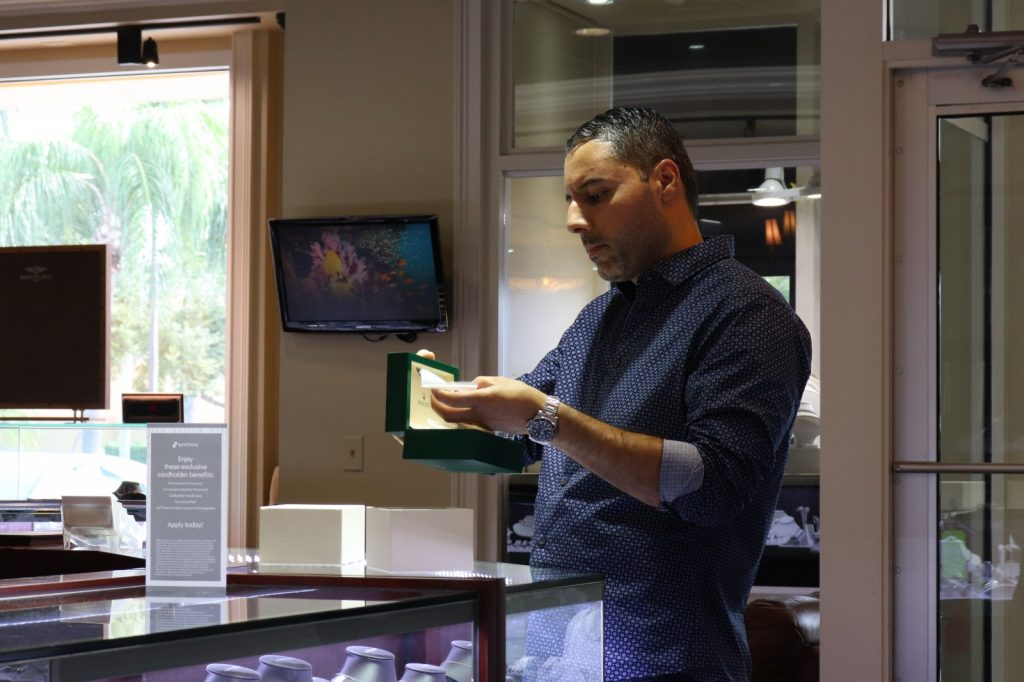 customer buying a rolex watch at diamonds by raymond lee