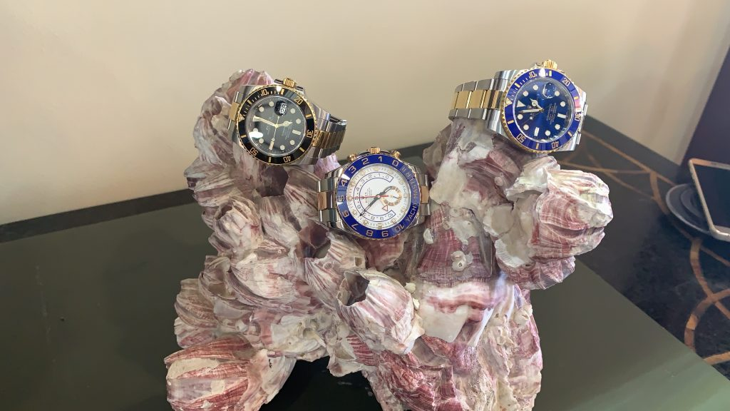 3 Rolex Yachtmaster Submariner watches on display for sale