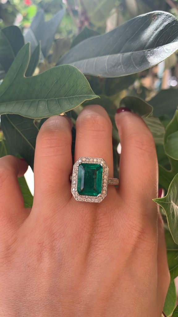 engagement ring emerald and diamond halo