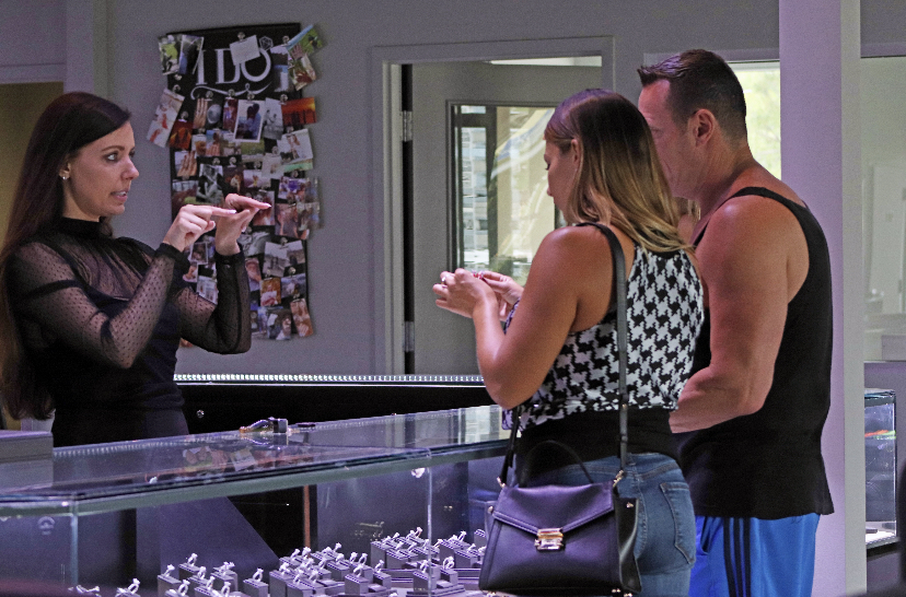 couple engagement ring shopping at jewelry showroom