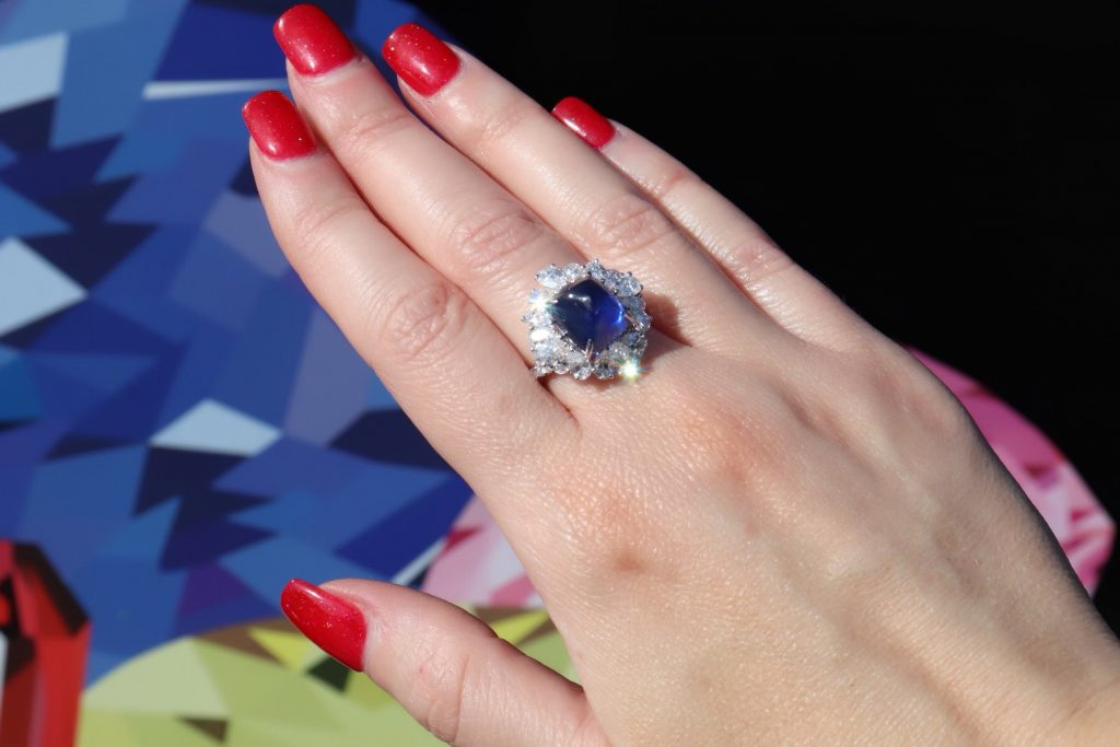 flower shaped diamond and sapphire ring