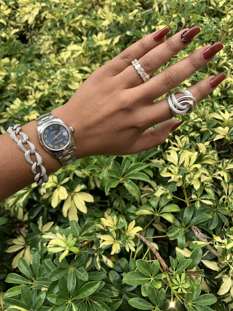 rolex watches for sale with roman dial worn with white gold jewelry and diamonds