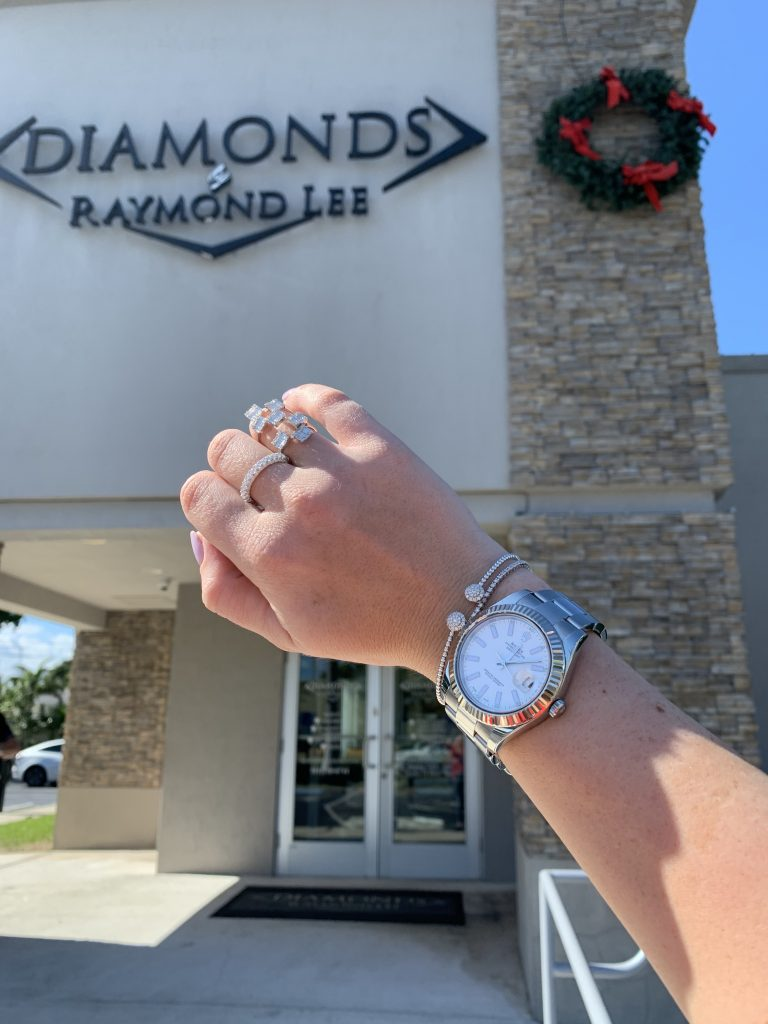 atejust watch held in front of diamonds by raymond lee the place to get great prices on Rolex