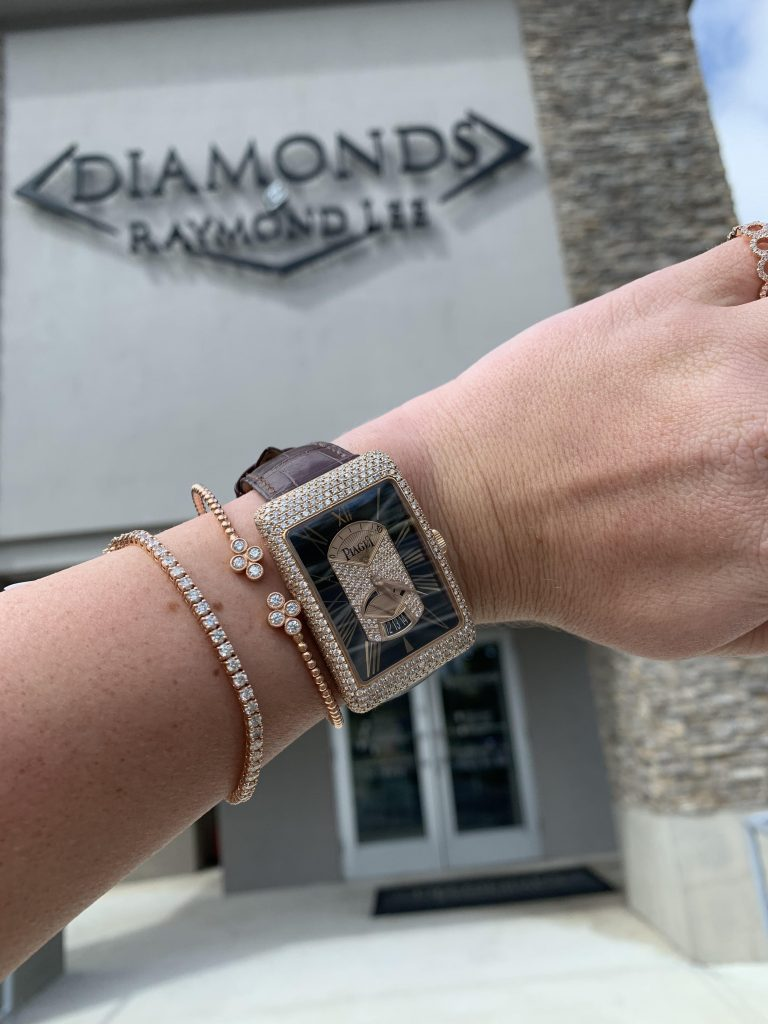 Piaget G0A29116 Black Tie 18k Rose Gold Diamond On Leather Strap Watch in front of diamond jewelry store
