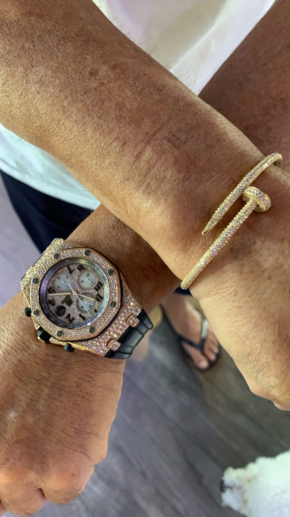 cartier bracelet and AP Royal Oak Offshore stainless steel watch