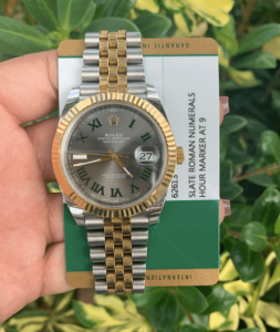 rolex watches for men held up with card