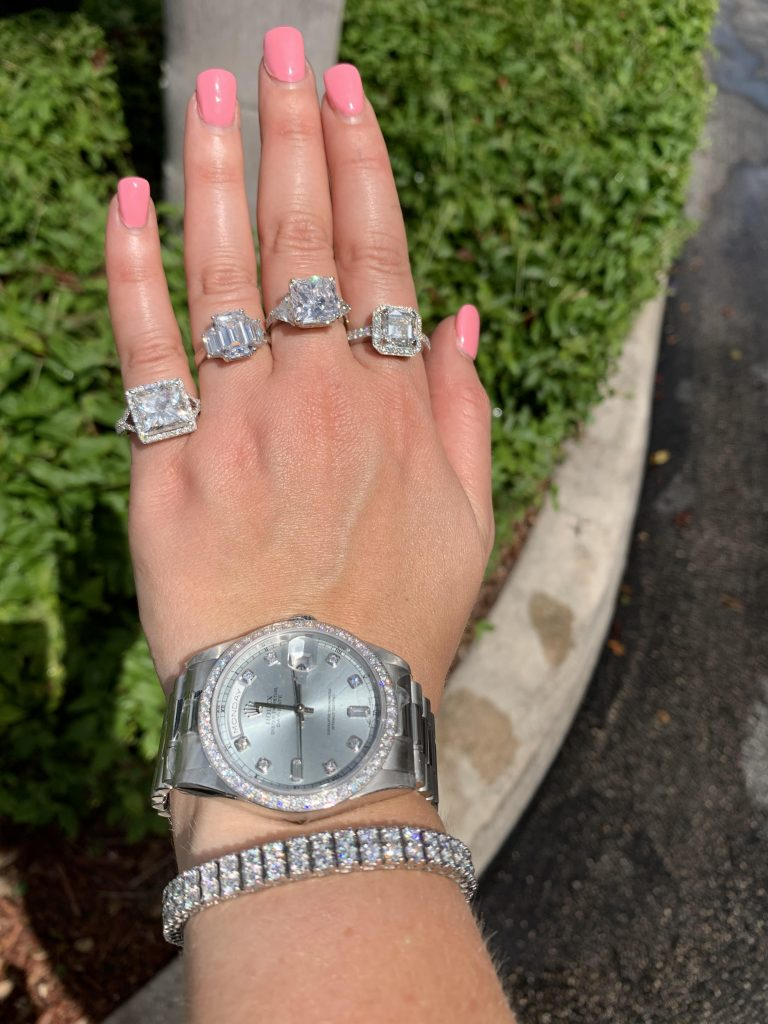 pre owned diamond watch worn with tennis bracelet and four diamond rings