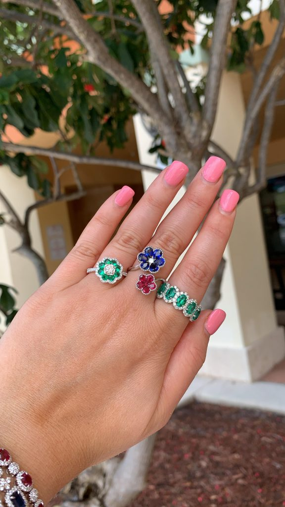 fine jewelry sapphire ring worn with emerald rings