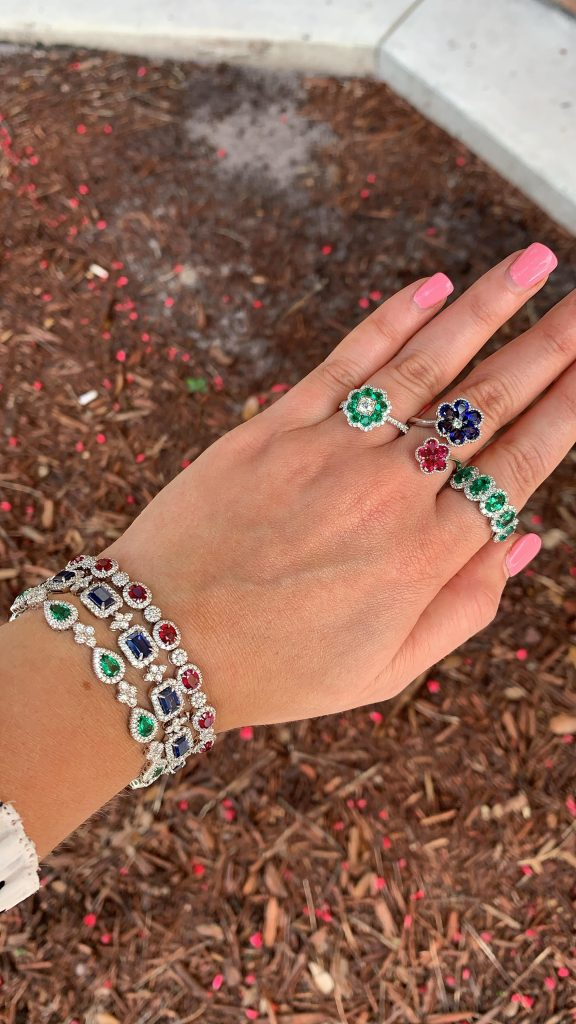 gemstone fine jewelry bracelets worn with sapphire ring and emerald rings