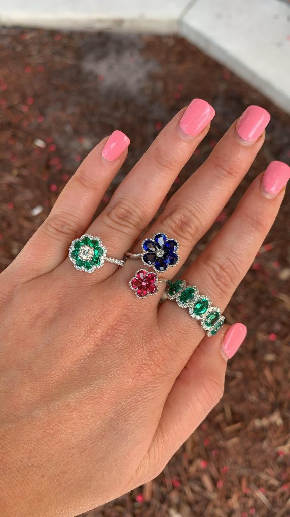 where to sell gemstone jewelry feature emerald rings worn alongside ruby and sapphire ring