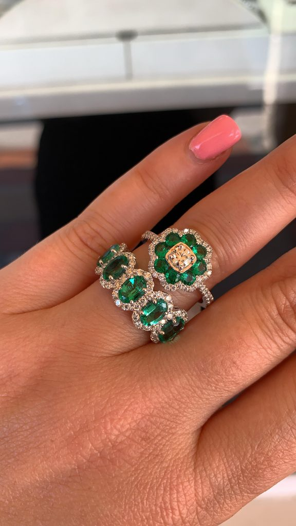 emerald rings worn together in a fine jewelry set