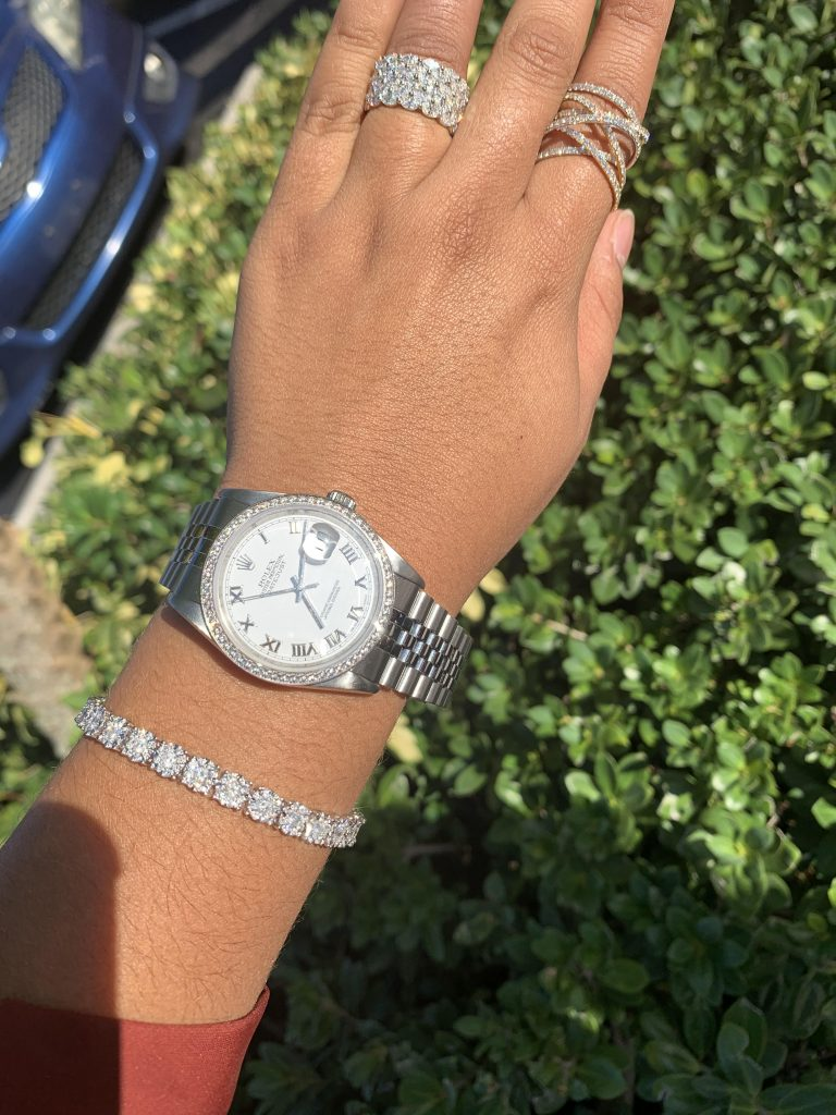 ladies gold watch worn with diamond bracelet and rings