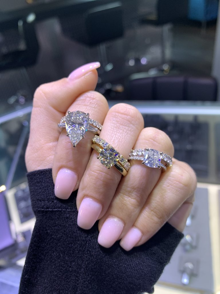 engagement rings worn at jewelry store in south florida