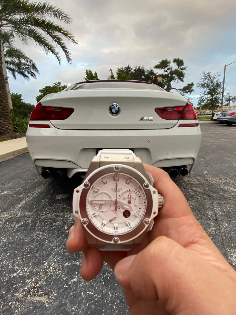 sports watches and luxury cars - hublot and bmw m6 gran coupe