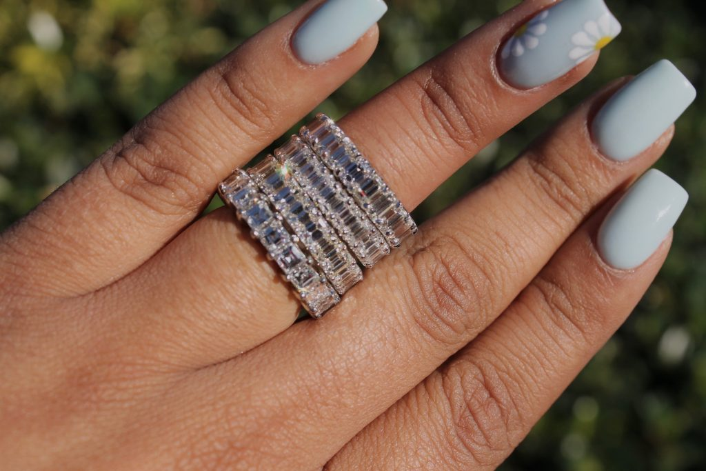 all diamond anniversary rings stacked together