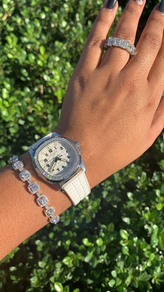 diamond jewelry worn with a patek philippe diamond bezel watch showing why jewelry is the best gift for valentine's day