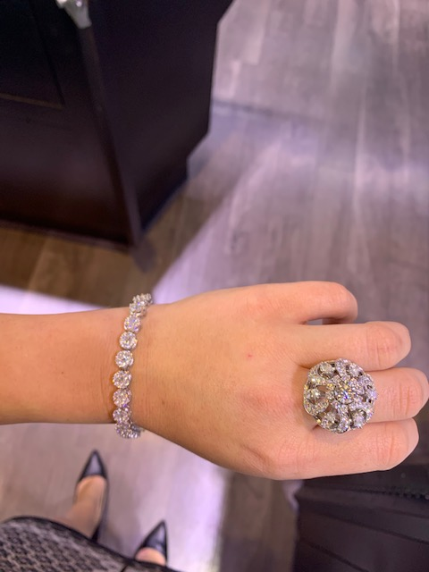 diamond jewelry worn together including tennis chain and ring