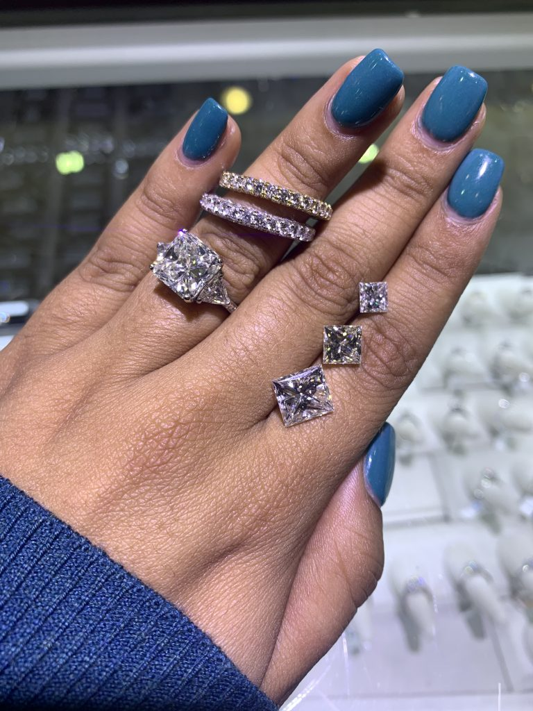 where to buy diamonds explainer showing diamonds and diamond jewelry on hand together