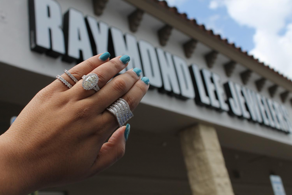 designer jewelry rings with diamonds worn in front of jewelry exchange boca