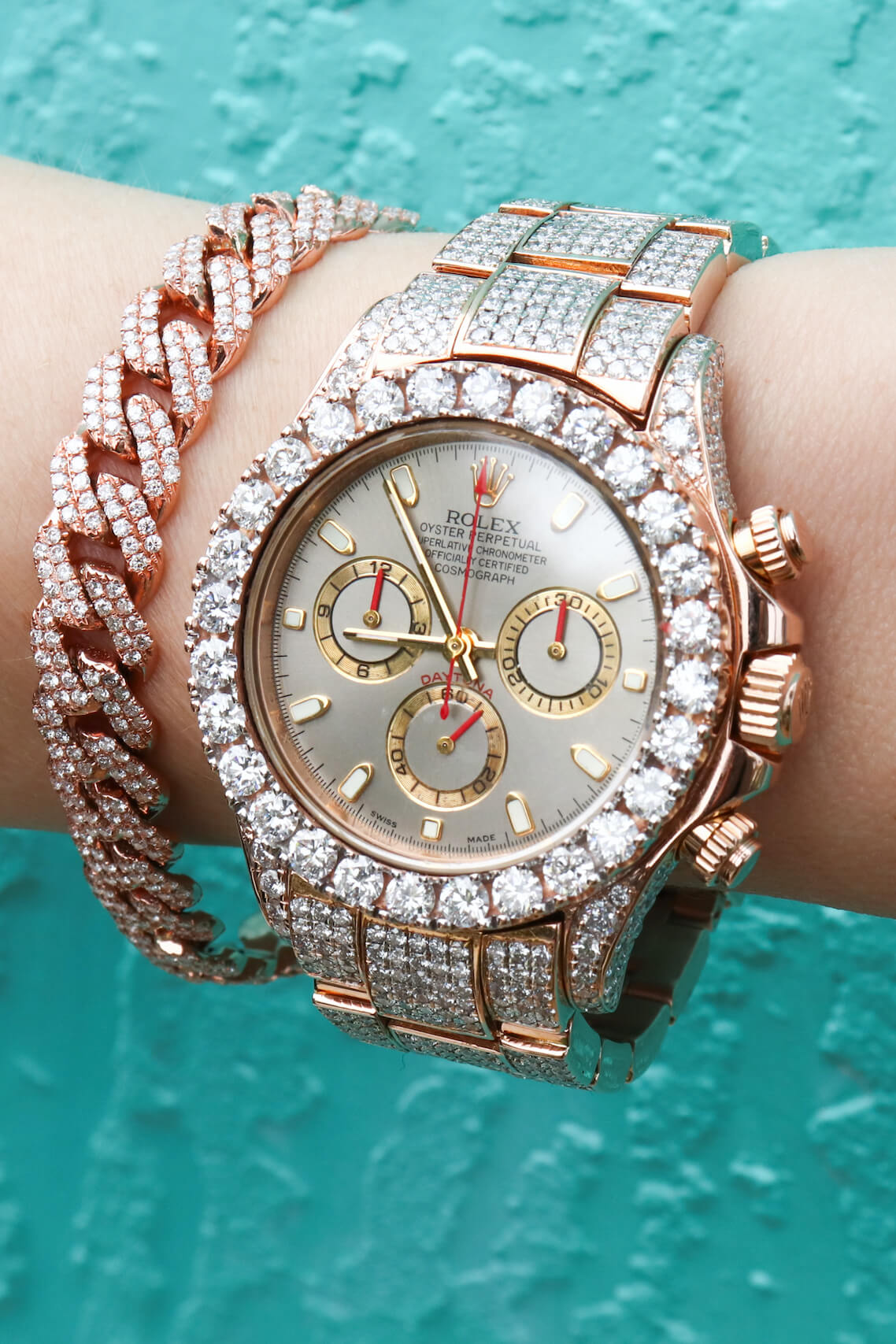Iced Out Rose Gold Rolex Daytona with Bust Down Cuban Link Bracelet